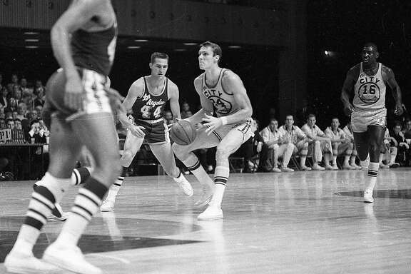 San Francisco Warrior guard Rick Barry is guarded by Jerry West, during a game against the Lakers at the Civic Auditorium.  Nov. 11, 1966.