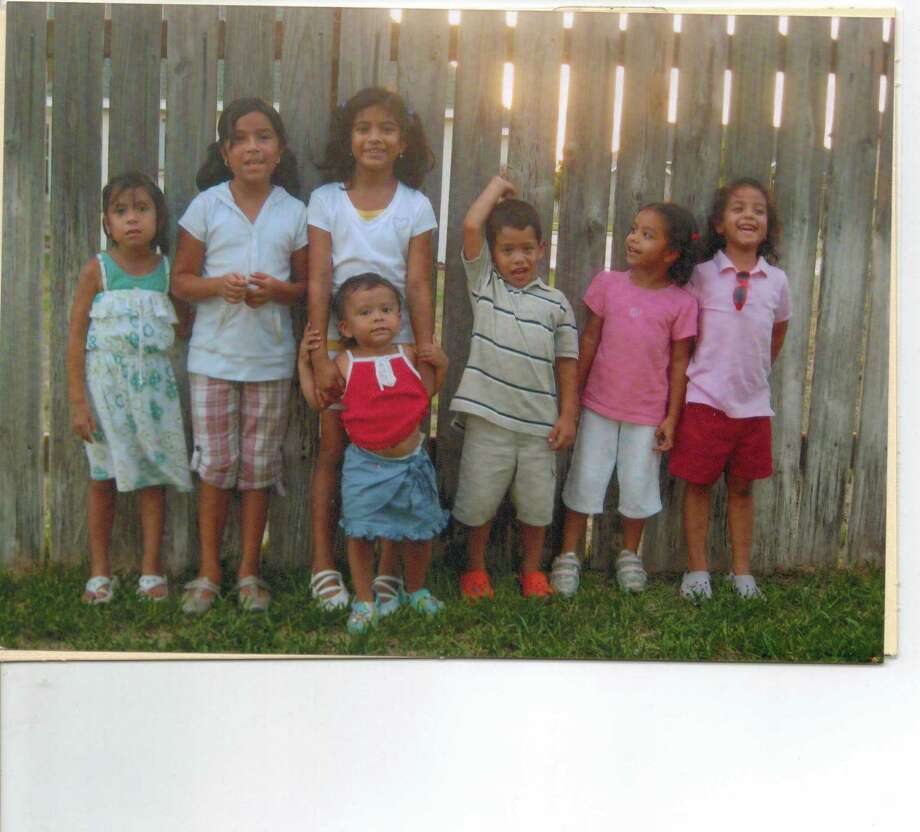 Sophia Hernandez (from left), Brianna Salinas, Victoria Hernandez, Jose Hernandez III, Cristina Hernandez, Alessia Hernandez and Maya Hernandez in front of Victoria Hernandez, July 2008, Del Rio. Photo: COURTESY