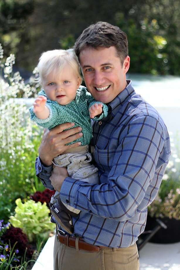 Jason Burnett and his son, Sebastian, play in the garden. Jason Burnett is Carmel's new mayor. While he has new responsibilities as the mayor he also has responsibilities as a new father. Photo: Sean Culligan, The Chronicle