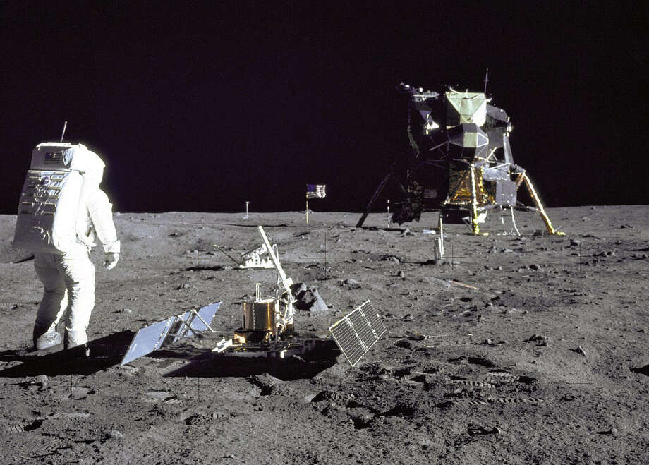 "Edwin E. ""Buzz"" Aldrin Jr. is shown just after deploying the Early Apollo Scientific Experiments Package. The Passive Seismic Experiment Package is in the foreground. Beyond it is the Laser Ranging Retro-Reflector. In the background are the black and white lunar surface television camera (left) and Lunar Module Eagle.Each of the six Apollo missions to reach the Moon left behind its Lunar Module descent stage stayed behind, a flag, scientific instruments, cameras, tools, backpacks, helmets and gloves. Casting off weight allowed the astronauts to bring back more Moon rocks. Photo: Neil Armstrong/NASA"