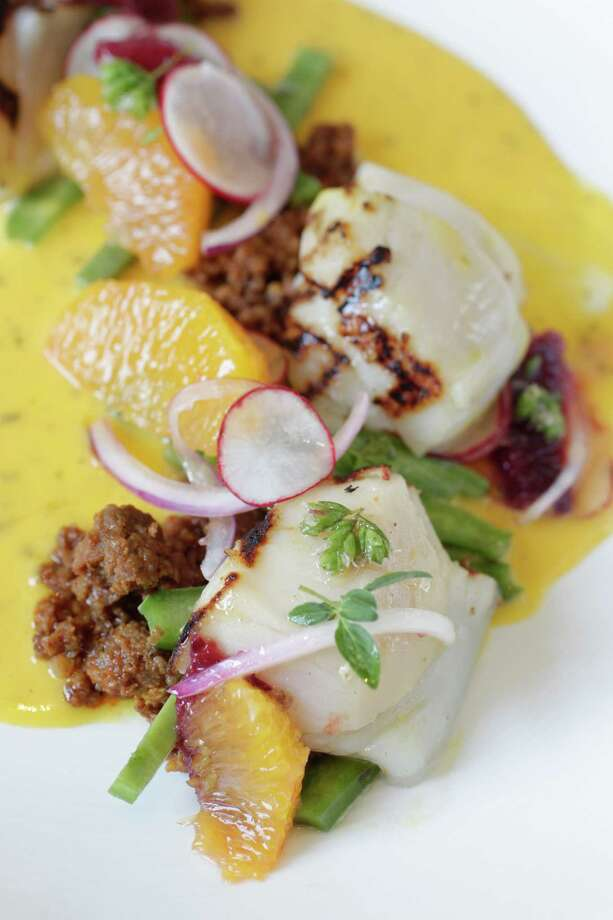Chef Jonathan Jones serves Scallops y Chorizo, grilled scallops, nopales, citrus, Mexcian oregano, chorizo, and chile manzano, at the new Mexican restaurant Concepcion on Wednesday, May 16, 2012, in Houston. ( Mayra Beltran / Houston Chronicle ) Photo: Mayra Beltran / Houston Chronicle