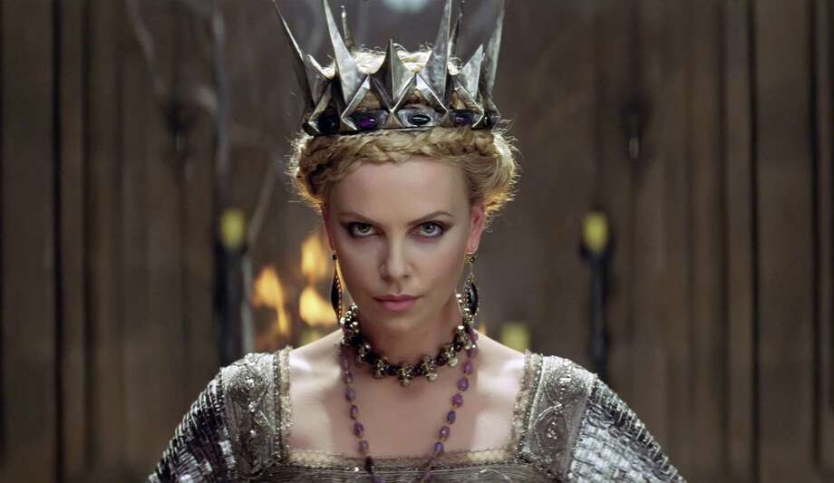 "This film image released by Universal Pictures shows actress Charlize Theron in a scene from ""Snow White and the Huntsman."" (AP Photo/Universal Pictures) Photo: AP, HOEP / Copyright: © 2012 Universal Studios. ALL RIGHTS RESERVED."