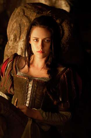 "This film image released by Universal Pictures shows Kristen Stewart in a scene from ""Snow White and the Huntsman"". (AP Photo/Universal Pictures) Photo: AP, Handout / ONLINE_YES"