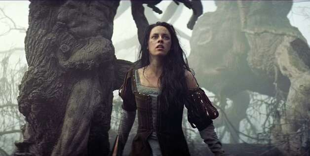 "This film image released by Universal Pictures shows Kristen Stewart in a scene from ""Snow White and the Huntsman"". (AP Photo/Universal Pictures) Photo: AP, HOEP / Copyright: © 2012 Universal Studios. ALL RIGHTS RESERVED."