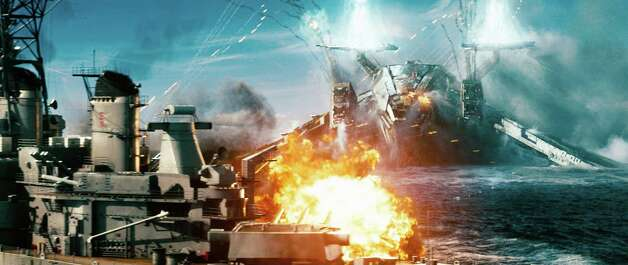 "In this film publicity image released by Universal Pictures, a naval ship is attacked by an invader in a scene from ""Battleship."" (AP Photo/Universal Pictures) Photo: AP, HONS / Copyright: © 2012 Universal Studios. ALL RIGHTS RESERVED."