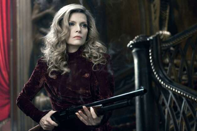 "In this film image released by Warner Bros., Michelle Pfeiffer portrays Elizabeth Collins Stoddard in a scene from ""Dark Shadows."" (AP Photo/Warner Bros., Peter Mountain) Photo: AP, HONS / © 2012 Warner Bros. Entertainment Inc. - U.S., Canada, Bahamas & Bermuda. © 2012 Village Roadshow Films (BVI) Limited – All othe"