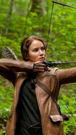 Jennifer Lawrence portrays Katniss Everdeen in Hunger Games, which opens at midnight Thursday.  Photo provided by Lionsgate Photo: Provided