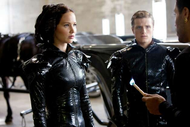 Jennifer Lawrence and Josh Hutcherson from a scene in the Hunger Games.  Photo provided by Lionsgate Photo: Provided