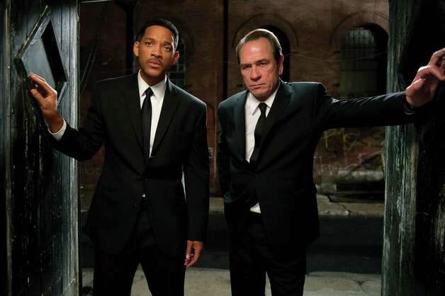 "In this film image released by Sony Pictures, Tommy Lee Jones, right, and Will Smith star are shown in a scene from ""Men in Black 3."" (AP Photo/Columbia Pictures-Sony, Wilson Webb) Photo: AP, HONS / © 2012 Columbia Pictures Industries, Inc.  All rights reserved."