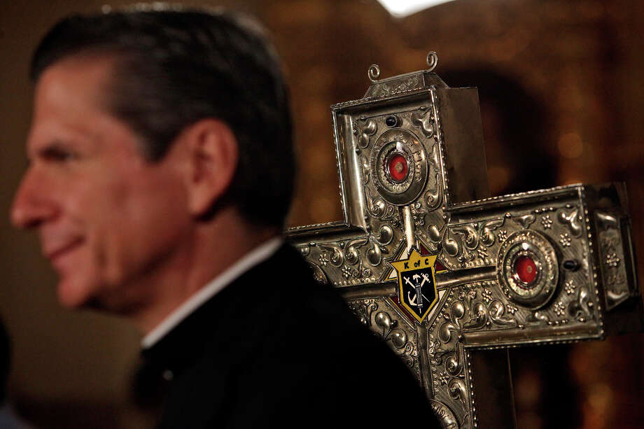 Archbishop Gustavo García-Siller stands next to a silver, cross-shaped box at San Fernando Cathedral containing the relics of six Knights of Columbus priests — now Catholic saints — who were martyrs of the Cristero War on Wednesday, May 30, 2012. Photo: Lisa Krantz, San Antonio Express-News / SAN ANTONIO EXPRESS-NEWS