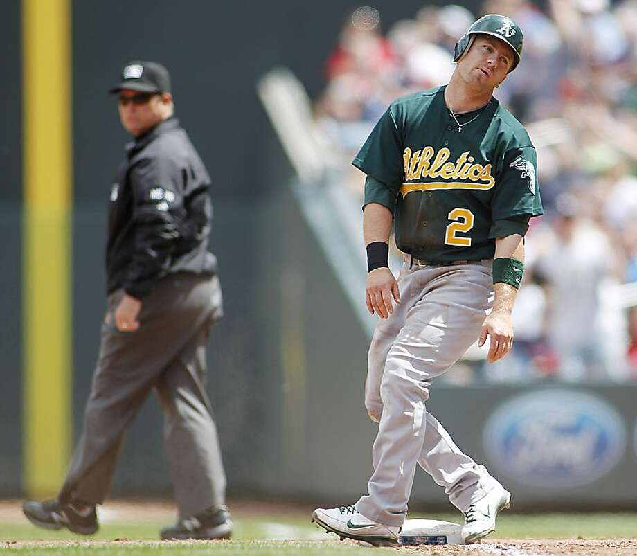 Oakland Athletics Cliff Pennington reacts after getting called out by first base umpire Marvin Hudson, left, on a double play after he was caught off first base during the eight inning of a baseball game against the Minnesota Twins, Wednesday, May 30, 2012 in Minneapolis.(AP Photo/Andy King) Photo: Andy King, Associated Press