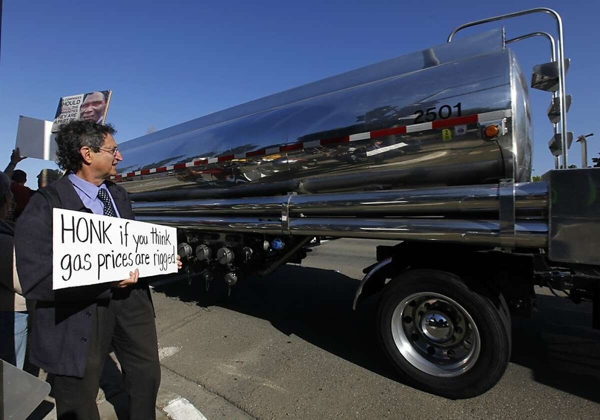 The driver of a gasoline tanker truck did not honk as he drove past Michael Beer and others protesting during a shareholders meeting at Chevron corporate offices in San Ramon, Calif. on Wednesday, May 30, 2012.