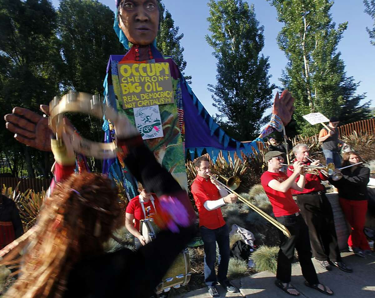 The Brass Liberation Orchestra performs at a protest during a shareholders meeting at Chevron corporate offices in San Ramon, Calif. on Wednesday, May 30, 2012.