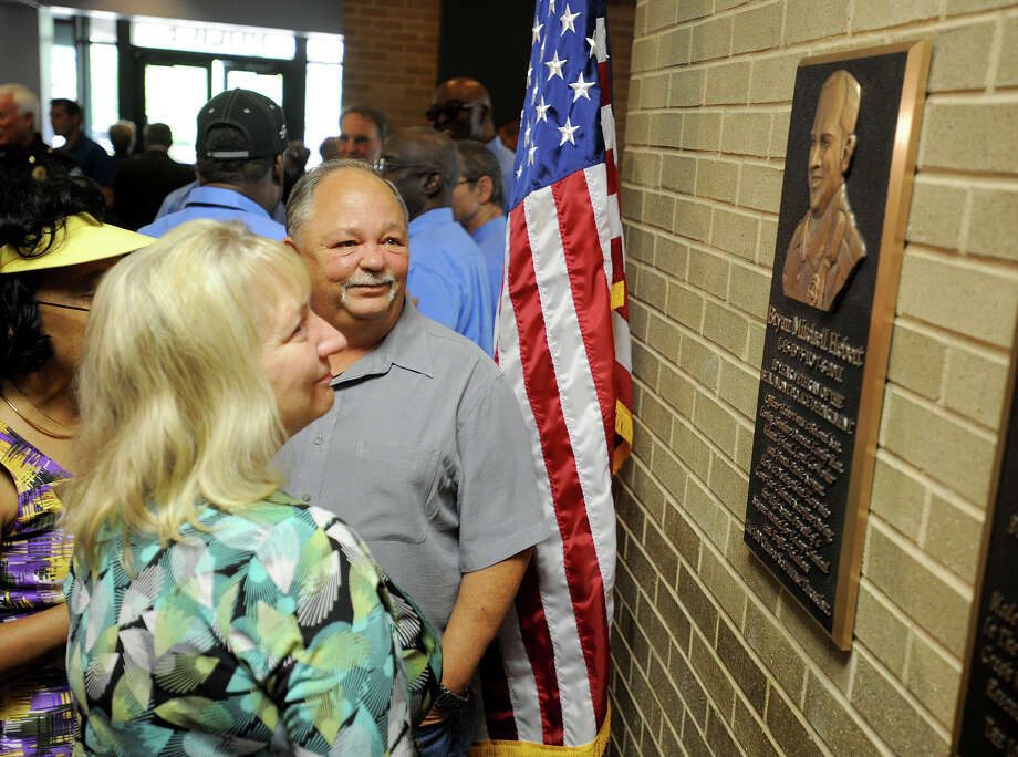 Cyndi and Glenn Hebert look at a bronze likeness of their son Bryan Hebert who was killed in the line of duty last year. Unveiled Wednesday by the Beaumont Police Department and the 100 Club of Southeast Texas, the plaque will hang permanently next to similar memorials for other fallen officers.  Photo taken Wednesday, May 30, 2012 Guiseppe Barranco/The Enterprise Photo: Guiseppe Barranco, STAFF PHOTOGRAPHER / The Beaumont Enterprise