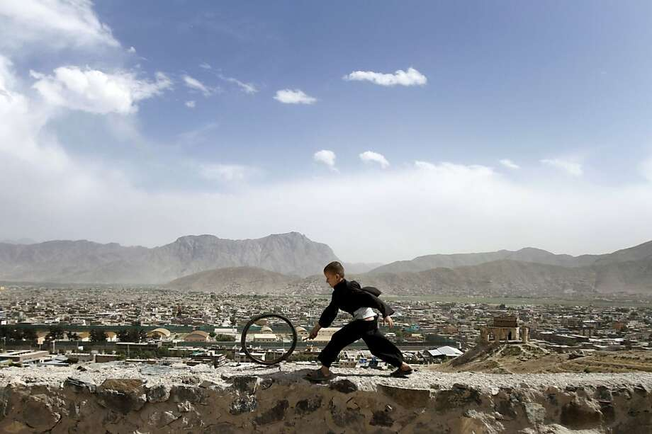 An Afghan boy pushes a wheel on the Naderkhan hill in Kabul, Afghanistan, Wednesday, May, 30, 2012, (AP Photo/ Ahmad Jamshid) Photo: Ahmad Jamshid, Associated Press