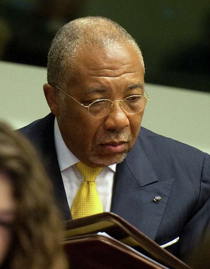 Former Liberian President Charles Taylor, 64, draws a 50-year sentence for his role in atrocities committed in Sierra Leone during its civil war in the 1990s. Photo: TOUSSAINT KLUITERS, Associated Press / POOL REUTERS