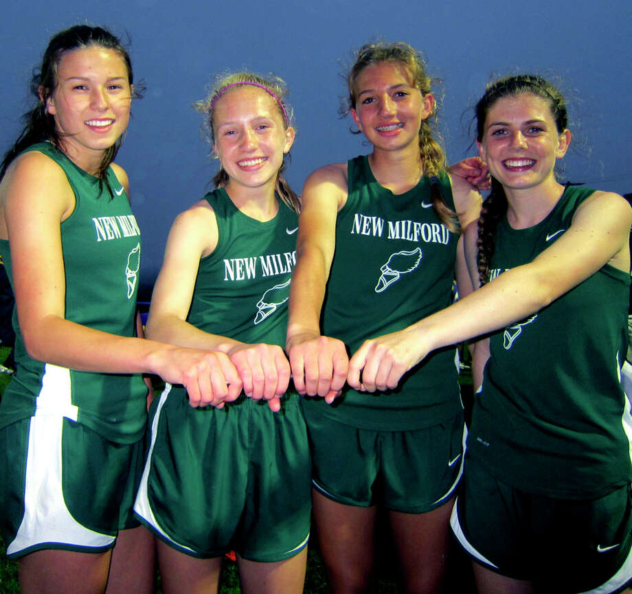Bonding with their baton following a record-break effort in the 4 x 400-meter relay are Green Wave teammates, from left to right, Lindsay Guptill, Helen Bayers, Sierra Grazia and Meghan Dietter. The New Milford High School girls' track quartet thus echoed success they'd enjoyed in the South-West Conference, the state and regionally during the wintertime indoor season. May 20, 2012 Photo: Norm Cummings