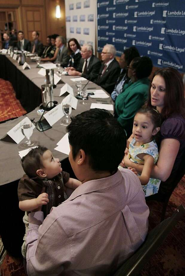 Claudia Mercado, left, holds her son Indigo Lopez-Mercado as Angelica Lopez right, holds the couples other child Isabel Lopez-Mercado as they gather for a news conference, Wednesday, May 30, 2012, in Chicago. More than two dozen gay Illinois couples who say it's unconstitutional for the state to deny them the right to marry and will file two lawsuits Wednesday, a move advocates believe could lead to legalized gay marriage in Illinois. The two lawsuits, filed by attorneys with the American Civil Liberties Union of Illinois and New-York based gay advocacy group Lambda Legal, include couples from Chicago and its suburbs, Bloomington and Marion. (AP Photo/M. Spencer Green) Photo: M. Spencer Green, Associated Press