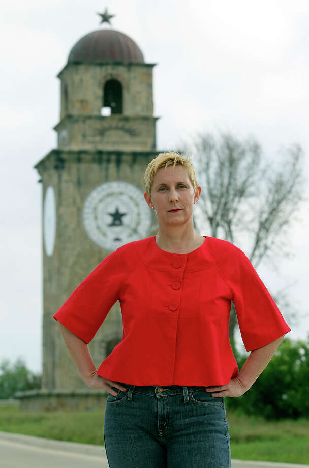 "Sissy Bradford stands in front of the tower entrance to Texas A&M-San Antonio on Wednesday, May 30, 2012. Bradford provided one email that read, ""As a professor, do you have a right to live?"" Photo: Tom Reel, San Antonio Express-News / ©2012 San Antono Express-News"