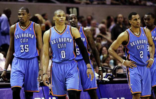 Oklahoma City Thunder's Kevin Durant (35), Russell Westbrook (0), Kendrick Perkins (5), Thabo Sefolosha (2) and Serge Ibaka (9) react against the San Antonio Spurs during the second half of Game 2 in their NBA basketball Western Conference finals playoff series, Tuesday, May 29, 2012, in San Antonio. (AP Photo/Eric Gay) Photo: Eric Gay, STF / AP