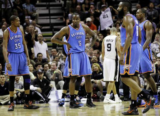 Oklahoma City Thunder small forward Kevin Durant (35) and Kendrick Perkins (5) react against the San Antonio Spurs during the first half of Game 2 in their NBA basketball Western Conference finals playoff series, Tuesday, May 29, 2012, in San Antonio. (AP Photo/Eric Gay) Photo: Eric Gay, STF / AP