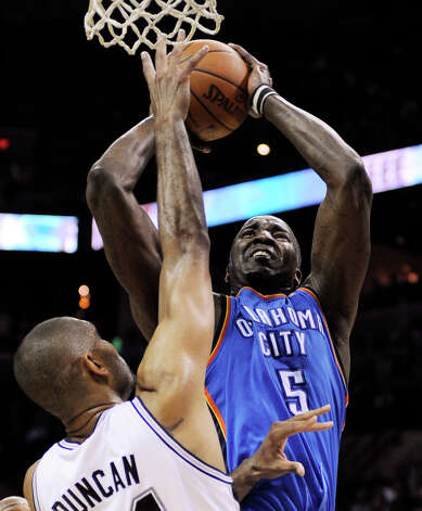 Oklahoma City Thunder center Kendrick Perkins (5) shoots as San Antonio Spurs center Tim Duncan (21) defends during the first half of Game 2 in their NBA basketball Western Conference finals playoff series, Tuesday, May 29, 2012, in San Antonio. (AP Photo/Darren Abate) Photo: Darren Abate, FRE / FR115 AP
