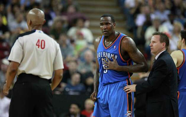Oklahoma City Thunder center Kendrick Perkins, center, questions official Leon Woods, about a foul call as Thunder coach Scott Brooks step1 in during the second half of an NBA basketball game in Sacramento, Calif., Friday, April 20, 2012.  The Thunder won 103-92.(AP Photo/Rich Pedroncelli) Photo: Rich Pedroncelli, STF / AP