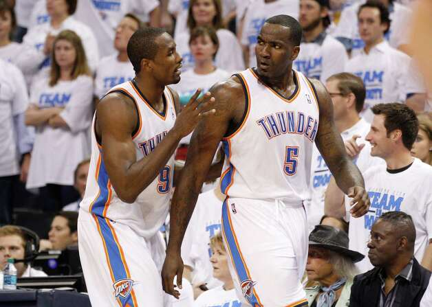 Oklahoma City Thunder forward Serge Ibaka , left, pushes teammate Kendrick Perkins, right, away from an altercation in the quarter of Game 2 in the first round of the NBA basketball playoffs against the Dallas Mavericks in Oklahoma City, Monday, April 30, 2012. (AP Photo/Sue Ogrocki) Photo: Sue Ogrocki, STF / AP