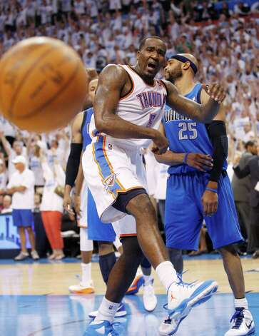 Oklahoma City Thunder center Kendrick Perkins, left, and Dallas Mavericks guard Vince Carter (25) react at the end of Game 2 in the first round of the NBA basketball playoffs, in Oklahoma City, Monday, April 30, 2012. Oklahoma City won 102-99. (AP Photo/Sue Ogrocki) Photo: Sue Ogrocki, STF / AP