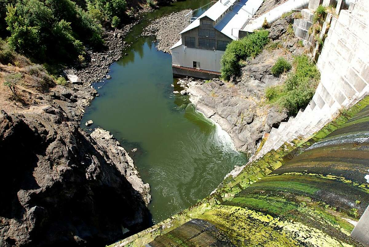 This Aug. 21, 2009 photo shows water trickling over Copco 1 Dam on the Klamath River outside Hornbrook, Calif. Northwest lawmakers introduce a bill in Congress on Thursday, Nov. 10, 2011, authorizing two landmark agreements to remove this dam and three others owned by PacifiCorp on the river to help salmon, and to assure farmers of irrigation.