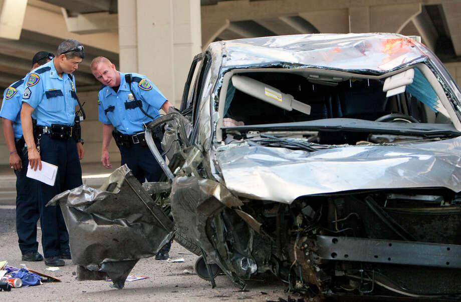 Police investigate an accident after a woman jumped the barrier of a slip ramp from Katy Freeway onto the 290 HOV lane Wednesday, May 30, 2012, in Houston. The driver was traveling at a high rate of speed when she jumped the barrier and hit the TxDot Field Office under the overpass. She was taken to Memorial Hermann Memorial and was conscious and breathing. Photo: Cody Duty, Houston Chronicle / © 2011 Houston Chronicle