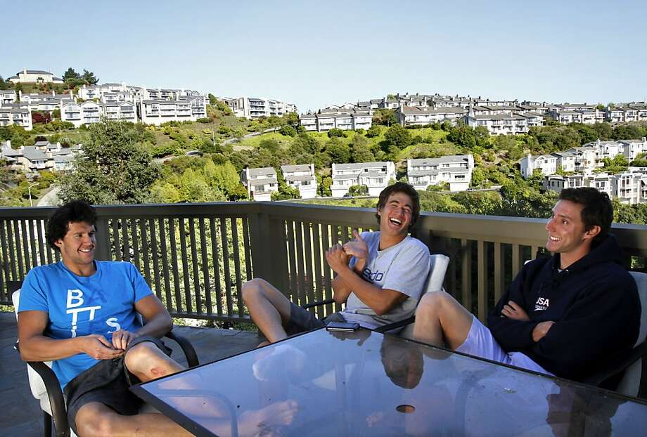 Swimmers Will Copeland, 26, right, Nathan Adrian, 23, center, and Graeme Moore, 23, left, relax at home in Berkeley, Calif. Monday, May 28, 2012.  The three are training for the Olympics along with fellow swimmer Sean Mahoney, 23, and all four have been sharing a house. Photo: Sarah Rice, Special To The Chronicle