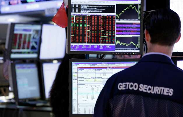A specialist works at his post at the New York Stock Exchange, Wednesday, May 30, 2012, in New York. Fearing a financial rupture in Europe, investors around the world fled from risk Wednesday. In the United States, where concerns about Europe have already wiped out most of this year's gains for stocks, major averages fell more than 1 percent. The Dow Jones industrial average was down as much as 184 points. European stocks lost even more, and the euro dropped below $1.24, its lowest point since the summer of 2010. (AP Photo/Richard Drew) Photo: Richard Drew