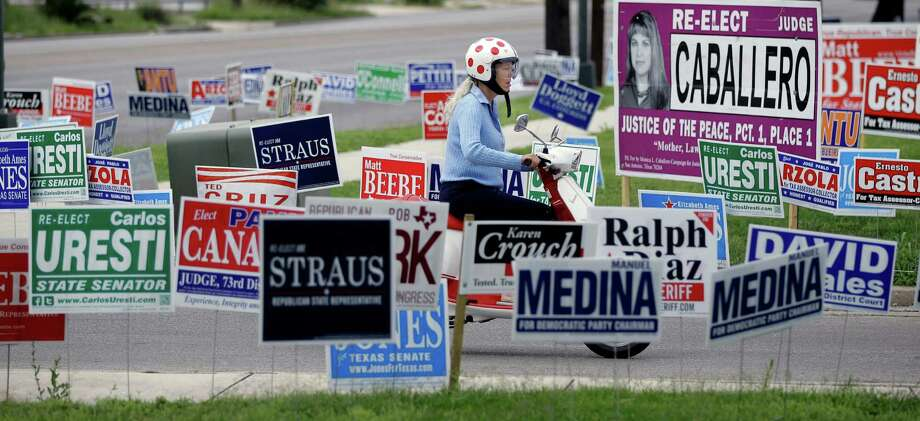 A reader voices disgust with the avalanche of negative campaign ads in the just-completed primary elections. Voters still face numerous primary election runoffs on July 31. Photo: AP