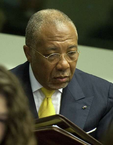 "Liberian ex-president Charles Taylor, accused of arming Sierra Leone's rebels who paid him in ""blood diamonds"", listens to the judge at the opening of the sentencing judgement hearing at the court in Leidschendam, near The Hague, on 30 May 2012. Former Liberian president Charles Taylor will be sentenced for war crimes by a UN court on May 30, 2012 after being convicted for arming Sierra Leone rebels in return for ""blood diamonds"".  Special Court for Sierra Leone judge Richard Lussick will deliver the ruling at a hearing due to start at 0900 GMT, the first sentence against a former head of state at an international court since the Nazi trials at Nuremberg in 1946. AFP PHOTO  ANP / POOL/ TOUSSAINT KLUITERSTOUSSAINT KLUITERS/AFP/GettyImages Photo: TOUSSAINT KLUITERS / AFP"