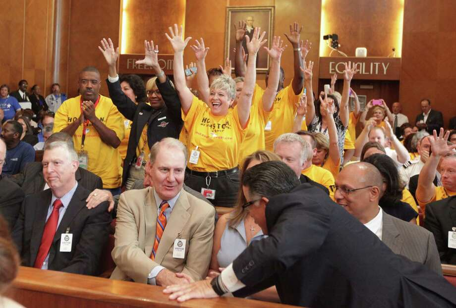 Southwest CEO Gary Kelly is congratulated as Southwest Airlines employees react to the City Council Members' approval of Hobby Airport expanding on Wednesday, May 30, 2012, in Houston. Houston City Council approved a $100 million expansion of Hobby Airport, which allows Southwest Airlines to start international flights for the first time in more than 40 years. Photo: Mayra Beltran, Houston Chronicle / Houston Chronicle