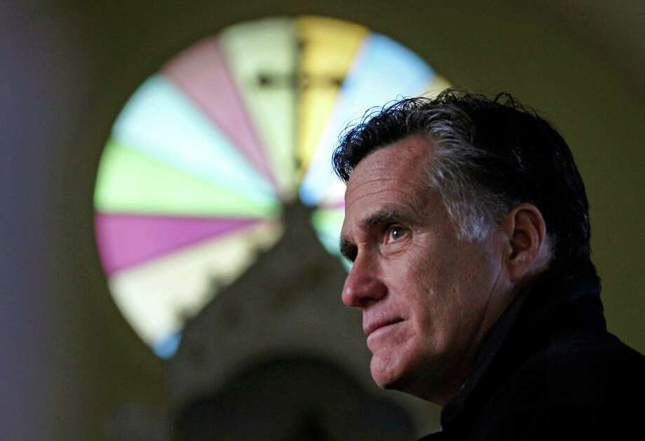 FILE - In this Thursday Dec. 22, 2011 file photo, Republican presidential candidate, former Mass. Gov. Mitt Romney, visits St. Paul's Lutheran Church while campaigning in Berlin, N.H. How unthinkable it was, not so long ago, that a presidential election would pit a candidate fathered by an African against another condemned as un-Christian. And yet, here it is: Barack Obama vs. Mitt Romney, an African-American and a white Mormon, representatives of two groups and that have endured oppression to carve out a place in the United States. How much progress has America made against bigotry? Photo: AP