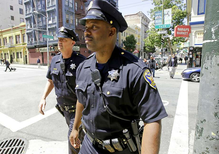San Francisco police officers, Sgt. Ian Furminger, (l) and Dennis Toomer,  work the Tenderloin district along Leavenworth St., on Wednesday May 30, 2012, in San Francisco, Ca. San Francisco Mayor Ed Lee, will announce he has a six year plan to restore police staffing to 1971 levels. Photo: Michael Macor, The Chronicle