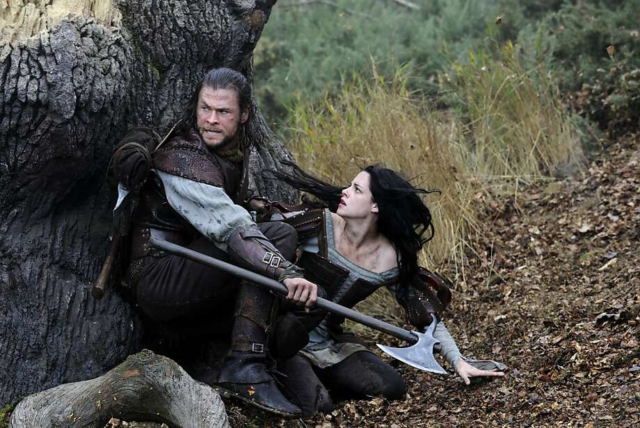 "The Huntsman (CHRIS HEMSWORTH) and Snow White (KRISTEN STEWART) in the epic action-adventure ""Snow White and the Huntsman"", the breathtaking new vision of the legendary tale from the producer of ""Alice in Wonderland"". Photo: Alex Bailey, Universal Pictures"