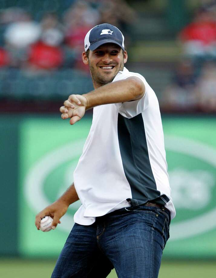 Dallas Cowboys quarterback Tony Romo winds up to throw the ceremonial first pitch before a baseball game between the Seattle Mariners and the Texas Rangers, Wednesday, May 30, 2012, in Arlington, Texas. Photo: AP