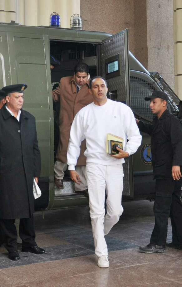 FILE - In this Monday, Jan. 9, 2012 file photo, Gamal Mubarak, center, son of former Egyptian president Hosni Mubarak, arrives at a court house in Cairo, Egypt. Mubarak and his two sons, one-time heir apparent Gamal and wealthy businessman Alaa, are already in prison and on trial on charges of corruption. A verdict is expected on June 2. (AP Photo/Mohammed al-Law, File) Photo: Mohammed Al-Law / AP