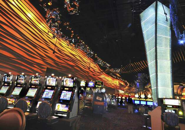 FILE - This Aug. 26, 2008 file photo shows the Casino of the Wind at Mohegan Sun in Uncasville, Conn. A 32-year-old Waterbury man was arrested Wednesday after State Police said he left his 8-month-old son alone in a car for more than seven hours while he was inside the casino. (AP Photo/Jessica Hill, File) Photo: Jessica Hill, Associated Press / AP2008