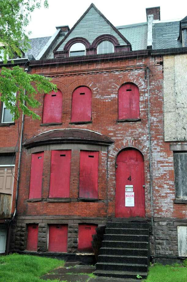 House at 4 McPherson Terrace in Albany Tuesday May 8, 2012, considered by Historic Albany to be one of the city's most endangered historic gems, which will be up for auction later this month.  (John Carl D'Annibale / Times Union) Photo: John Carl D'Annibale / 00017599A