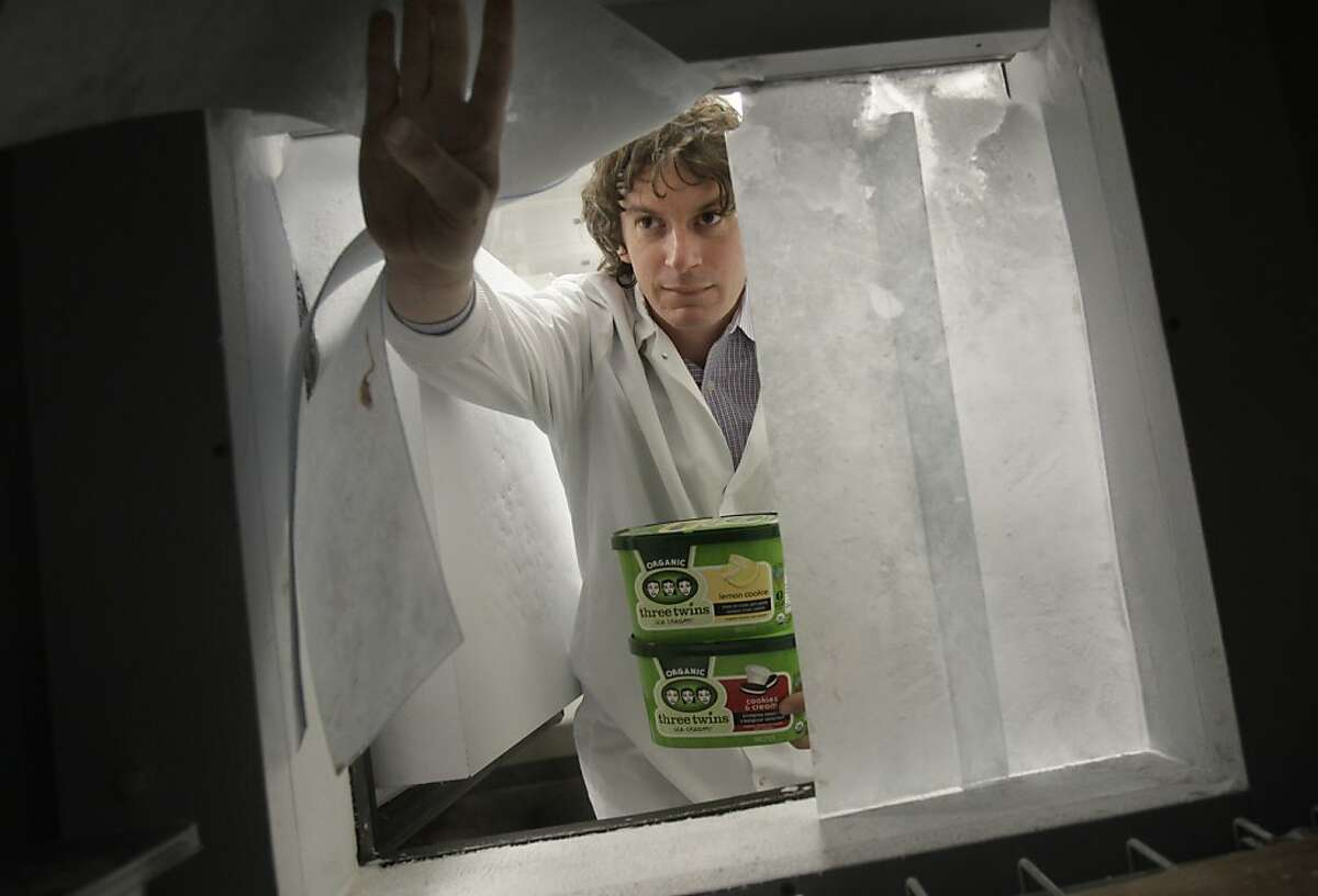 Founder Neal Gottlieb peers into the freezer compartment from the kitchen area. Hundreds of cartons of ice cream are kept frozen here. Three Twins Ice Cream is a local company that makes organic ice cream. Founder Neal Gottlieb visited the Petaluma, Calif. plant where they produce the ice cream Wednesday May 30, 2012.