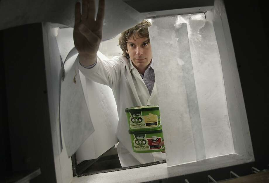 Founder Neal Gottlieb peers into the freezer compartment from the kitchen area.  Hundreds of cartons of ice cream are kept frozen here. Three Twins Ice Cream is a local company that makes organic ice cream. Founder Neal Gottlieb visited the Petaluma, Calif. plant where they produce the ice cream Wednesday May 30, 2012. Photo: Brant Ward, The Chronicle