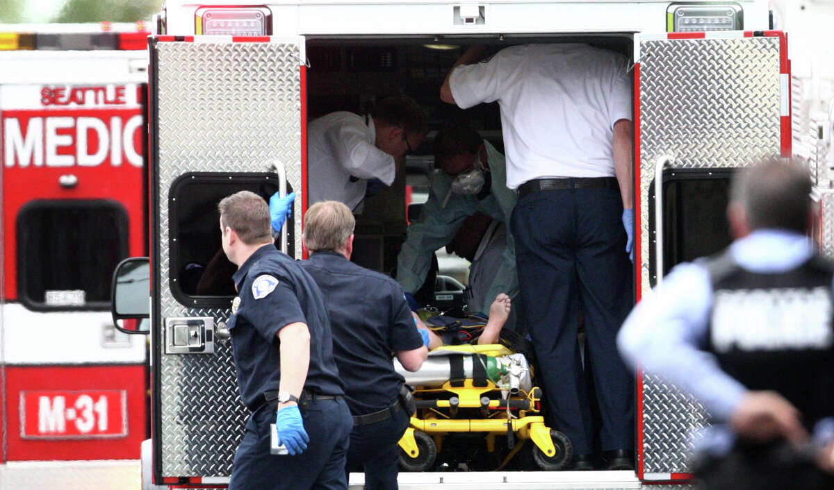 A victim is placed in an ambulance after five people were shot at Cafe Racer on Roosevelt Way NE in Seattle on Wednesday, May 30, 2012. Four of the victims died from the violence. Another person was shot and killed in downtown Seattle about 30 minutes later. Seattle Police said they believed it was the same suspect. The suspect later shot himself in West Seattle. He died at Harborview Medical Center.