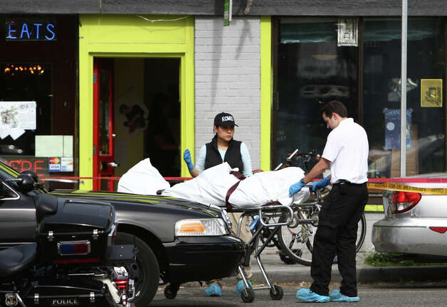 A body is removed after five people were shot at Cafe Racer on Roosevelt Way NE in Seattle. Photo: JOSHUA TRUJILLO / SEATTLEPI.COM