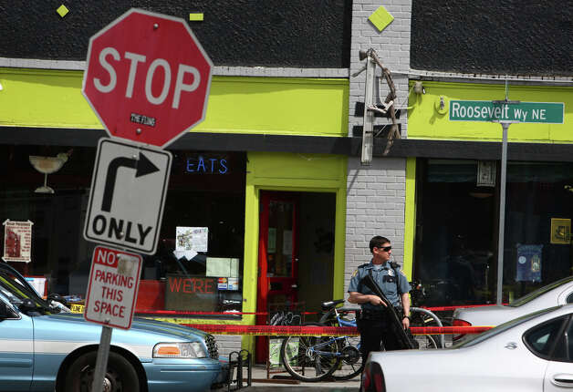 Seattle Police officers secure the scene after five people were shot at Cafe Racer on Roosevelt Way NE in Seattle. Photo: JOSHUA TRUJILLO / SEATTLEPI.COM