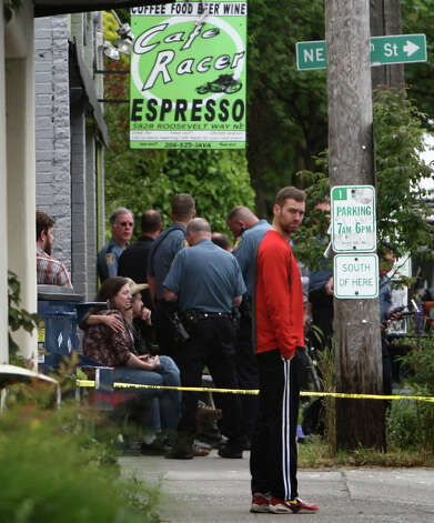 Officers interview witnesses after five people were shot at Cafe Racer. Photo: JOSHUA TRUJILLO / SEATTLEPI.COM