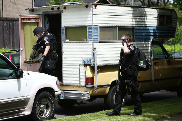 Seattle Police officers search a camper after five people were shot at Cafe Racer on Roosevelt Way NE. Photo: JOSHUA TRUJILLO / SEATTLEPI.COM